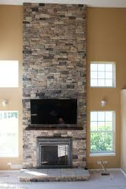 we built a frame over the existing drywall fireplace to create depth and allow us easier access to install the required wiring the stone is our m