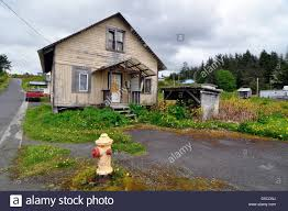 fire hydrant in front of house in kake alaska stock photo