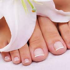 beautiful well groomed female feet with the french pedicure and