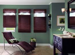 interior design white window with brown bali blinds on green wall