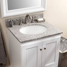 double white undermount sink combined with light gray granite top
