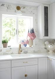 full height marble subway tile backsplash transitional kitchen