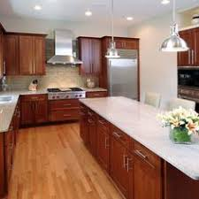 Medium Brown Kitchen Cabinets by Medium Brown Cabinets With White Quartz Countertop Google Search
