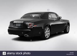 rolls royce rear 2009 rolls royce phantom coupe in black rear angle view stock