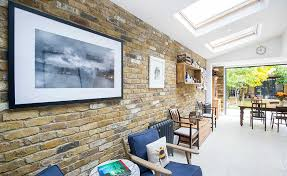 create a feature with an exposed brick wall real homes