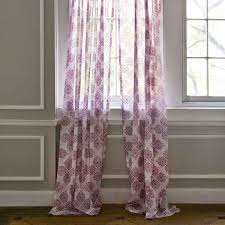 interior floral ikea curtains covering white wooden framed window