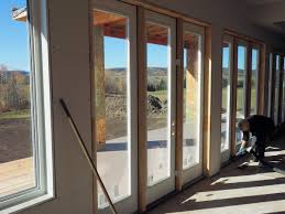 renoteck exteriors windows doors calgary edmonton interior view of windows and doors by supreme windows check the man cleaning up
