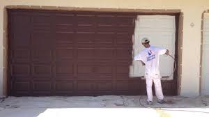 Insulating Garage Door Diy by Garage Painting A Garage Door Home Garage Ideas