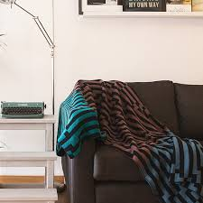 5 ways to style a modern throw blanket in the living room