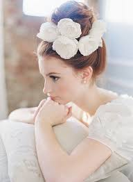 chiffon hairstyle cute topknot bun wedding hairstyle with chiffon flowers tulle