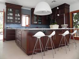 fetching brown wooden cabinets and white countertop for island at