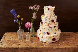 how to decorate a wedding or celebration cake with edible petals
