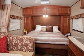 Small Bedroom Murphy Beds Small Bedroom With Murphy Bed Couch And Wooden Cabinet Andrea