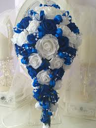 wedding flowers blue and white wedding flowers brides teardrop bouquet in royal blue and white