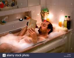Bathtub Reading Man Reading Book And Drinking Beer While Taking A Bath Stock Photo