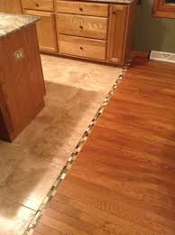 transition between hardwood and tile floor we should do this