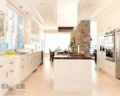 almond brittle porter paint color cabinets with st cecelia granite