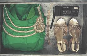 green hobo bag black disposable camera and pair of gold ankle