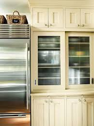 glass kitchen cabinets sliding doors glass front cabinetry better homes gardens
