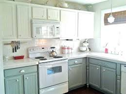 repainting oak kitchen cabinets painting kitchen cabinets before and after painted kitchen cabinets