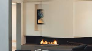 tv above fireplace fireplace tv modus fireplaces