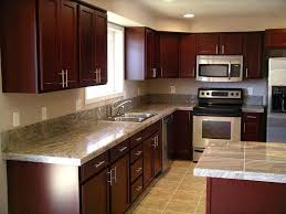 magnificent cherry red mahogany cabinets with white porcelain