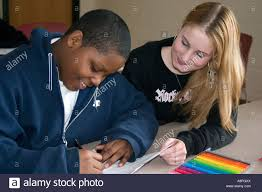 after school study tutor helping student with studies after school study program st