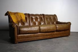 Mid Century Modern Tufted Sofa by Tufted Mid Century Faux Aged Leather Vinyl Sofa U2013 Abt Modern