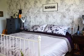 woman in real life the art of the everyday master bedroom mini as you can see there was already a lot of pattern going on in the master bedroom with the distinctive sketch floral wallpaper the black and white