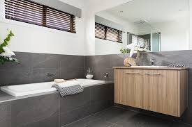 modern bathroom vanities near bathtub with grey granite backsplash