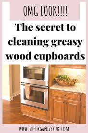 best cleaner for greasy kitchen cupboards how to clean sticky wood kitchen cabinets the organizer uk