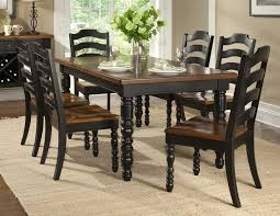 black and wood dining table distressed black dining room sets chairs seating gray fabric dining