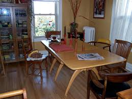 please share photos of your dining kitchen table no photos from my current house but i still use the same table a heywood wakefield harmonic table from the fifties here s a shot of it in my old