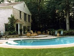 inground pool with aggregate pool deck flagstone patio and