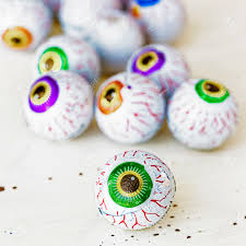chocolate candy eyeballs for halloween wrapped in foil stock