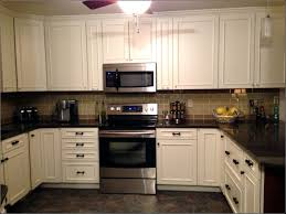kitchen backsplash tile with dark cabinets cookerware shelves