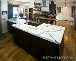 simple kitchen with poured concrete kitchen countertops stainless