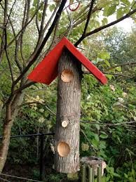 the woodpecker suet log feeder is as individual as the birds it