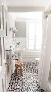small bathroom ideas with high contrast patterned floor tile small bathroom design ideas with multiple shelves