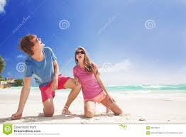 Tropical Clothes For Travel Couple In Bright Clothes Enjoying Sunny Day At Tropical Beach