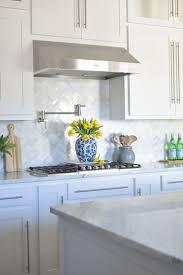 stone kitchen backsplash white cabinets mirror tile stainless