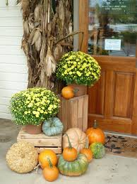 gourds pumpkins crates and fall blooms is an ultimate mix to