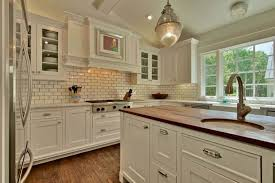 traditional kitchen backsplash traditional kitchen style with white cabinets and subway tile