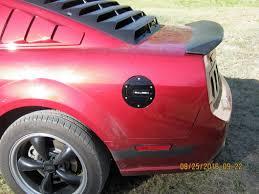 Pink And Black Mustang Saleen Mustang S281 Aluminum Fuel Door Black Finish 06 1110