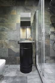 10 modern small bathroom ideas for dramatic design or remodeling loft is loft by martinarchitects is filled with dramatic moments including this bathroom with walls and floors covered in 12 x24 slate the black oil
