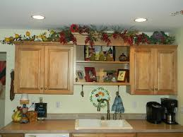 Decorating Ideas For Above Kitchen Cabinets Cabinet Garland For Above Kitchen Cabinets Decorating Above