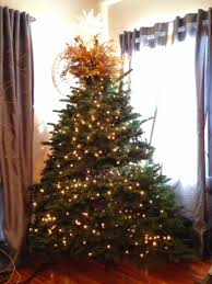 Decorate Christmas Tree Like Department Stores by How To String On Christmas Lights The Decorator Way Savvy In