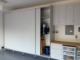 garage cabinets with sliding doors garage cabinets are made with sliding doors which saves space is