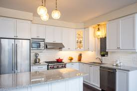 kitchen countertops with white cabinets luna pearl granite kitchen white cabinets and subway tile