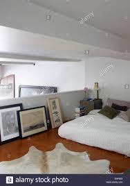 split level mezzanine bedroom artwork in kensington court mews
